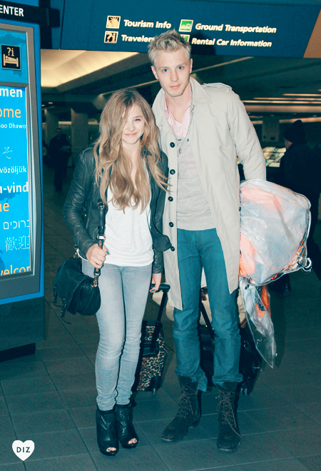 42326_Preppie_Chloe_Moretz_and_brother_Trevor_walk_through_LaGuardia_airport_in_New_York_2_122_366lo.jpg