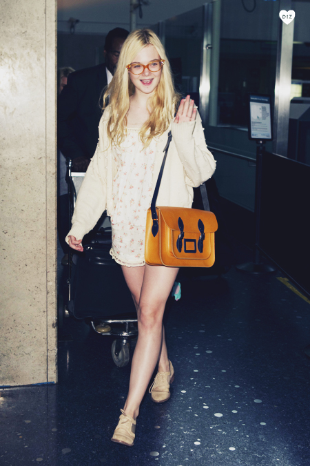 46615_Preppie_Elle_Fanning_arriving_at_LAX_Airport_1_122_123lo.jpg