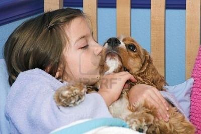 223914-a-little-girl-giving-her-puppy-a-kiss-goodnight.jpg
