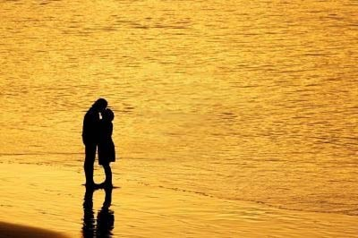 566051-couple-kissing-at-su.jpg