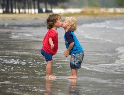 children-boy-girl-kiss-beac.jpg